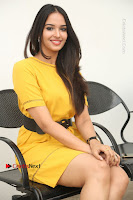 Actress Poojitha Stills in Yellow Short Dress at Darshakudu Movie Teaser Launch .COM 0264.JPG