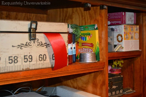 Craft supplies in an armoire