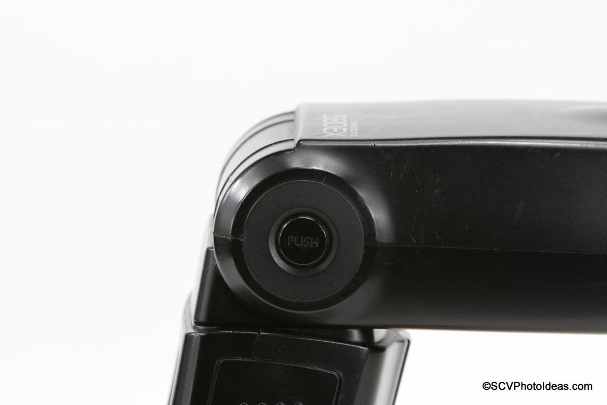 Canon Speedlite 580EX flash head release button