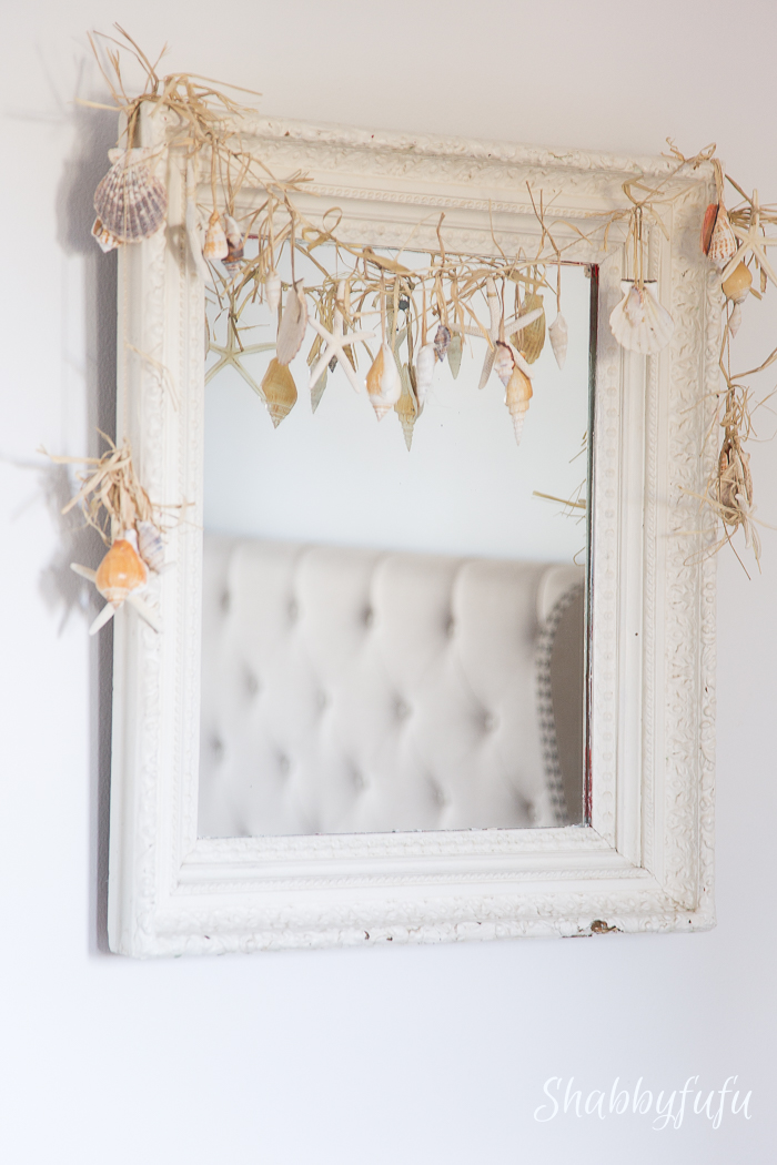 mirror with seashell garland