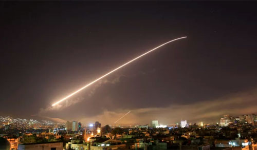 The Damascus sky lights up missile fire as the U.S. launches an attack on Syria targeting different parts of the capital early Saturday, April 14, 2018. Photo Hassan Ammar/AP