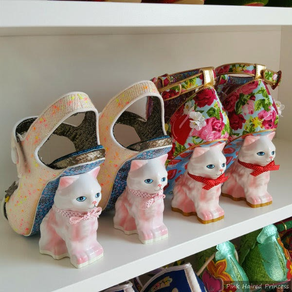 row of cat heels on shelf to compare old with new version