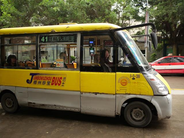 mini-mini Jumbo Wuzhou Bus with two passengers
