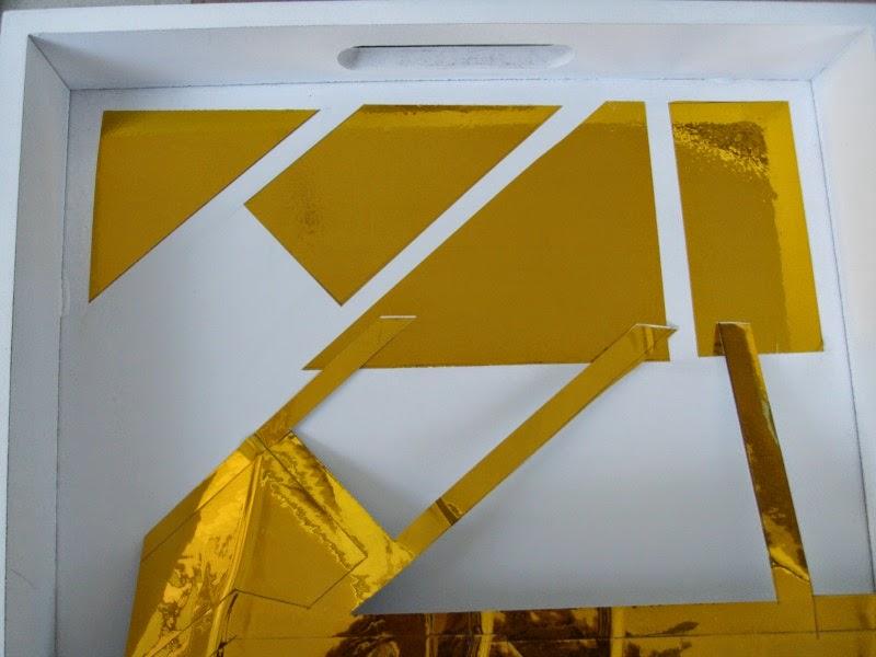 δίσκος με χρυσό αυτοκόλλητο