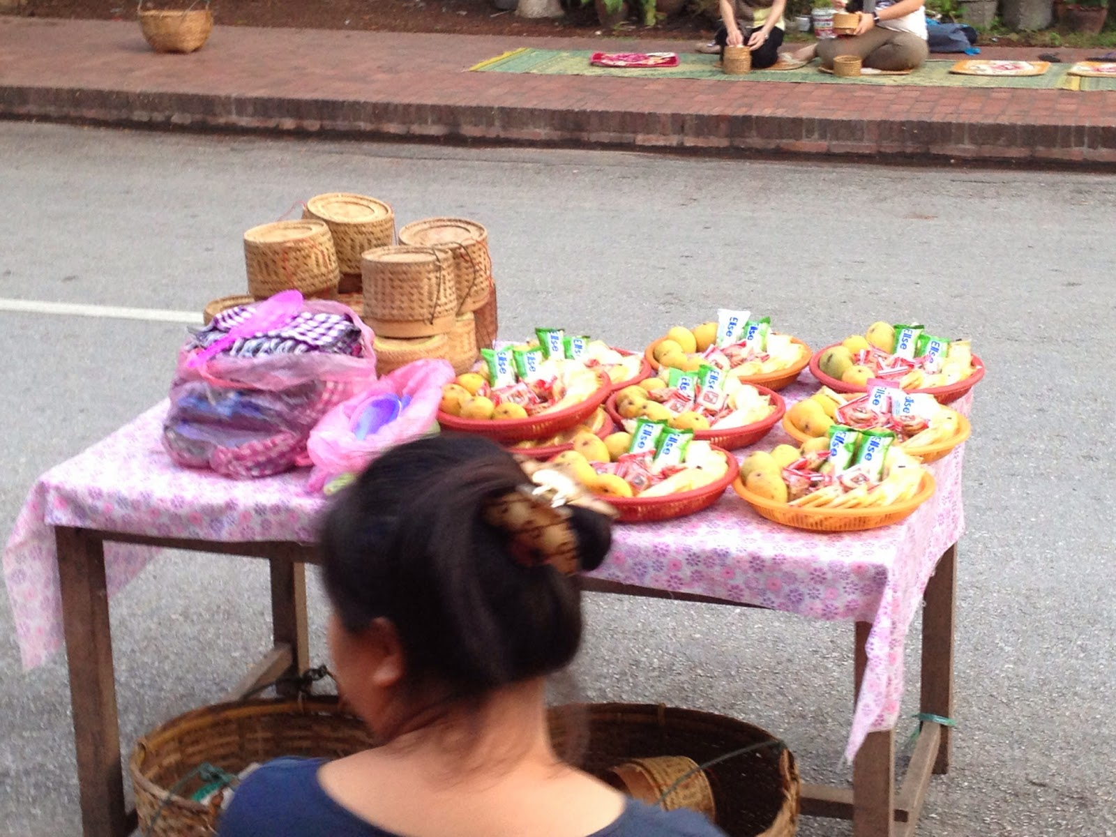 Luang Prabang - Locals selling food to be given to monks