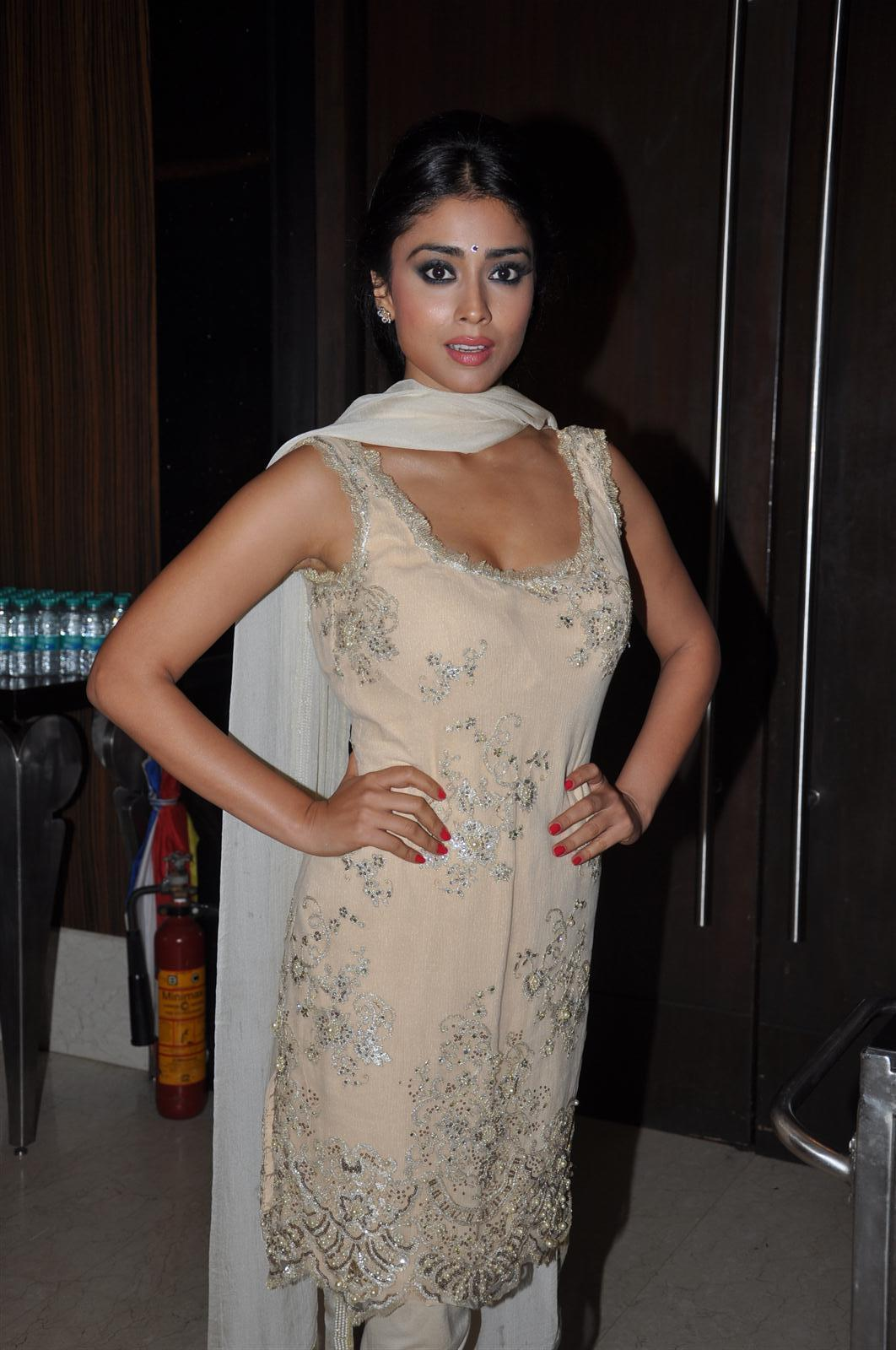 Actress Shriya Saran Sleeveless Photos In Yellow Dress