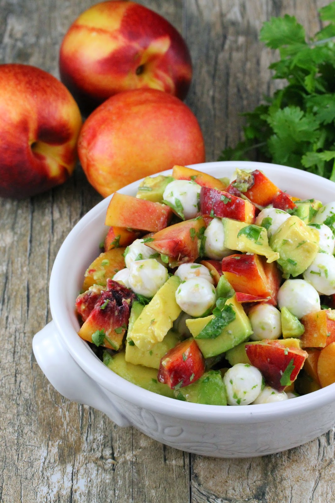 Nectarine and Avocado Fruit Salad with the sweetness of fresh nectarine, the creamy texture of avocado and fresh mozzarella and tossed with lime juice and cilantro