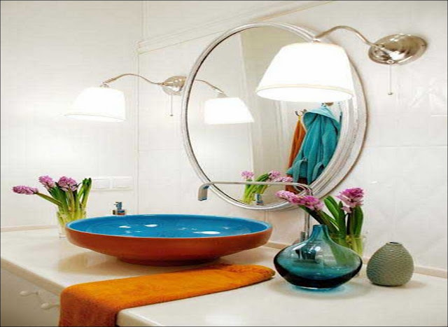 Round-ceramic-sink-in-turquoise-blue-and-orange-colors