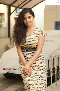 Telugu Actress Karunya Chowdary Stills in Short Dress at ATM Not Working Press Meet  0098.jpg