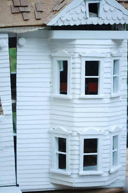 vintage doll house with old windows