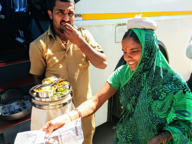 Local woman selling traditional lunch in front of Pattadakkal temple, Karnataka