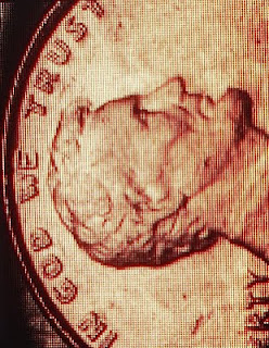 image of a penny with 'In God We Trust'
