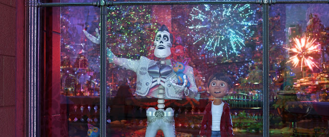 Pixar Coco Ernesto and Miguel look at fireworks