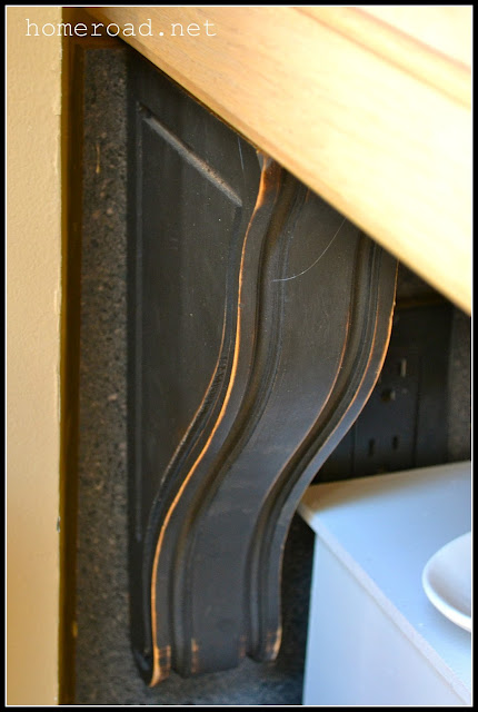 wooden corbels from the thrift store repurposed as kitchen corbels.