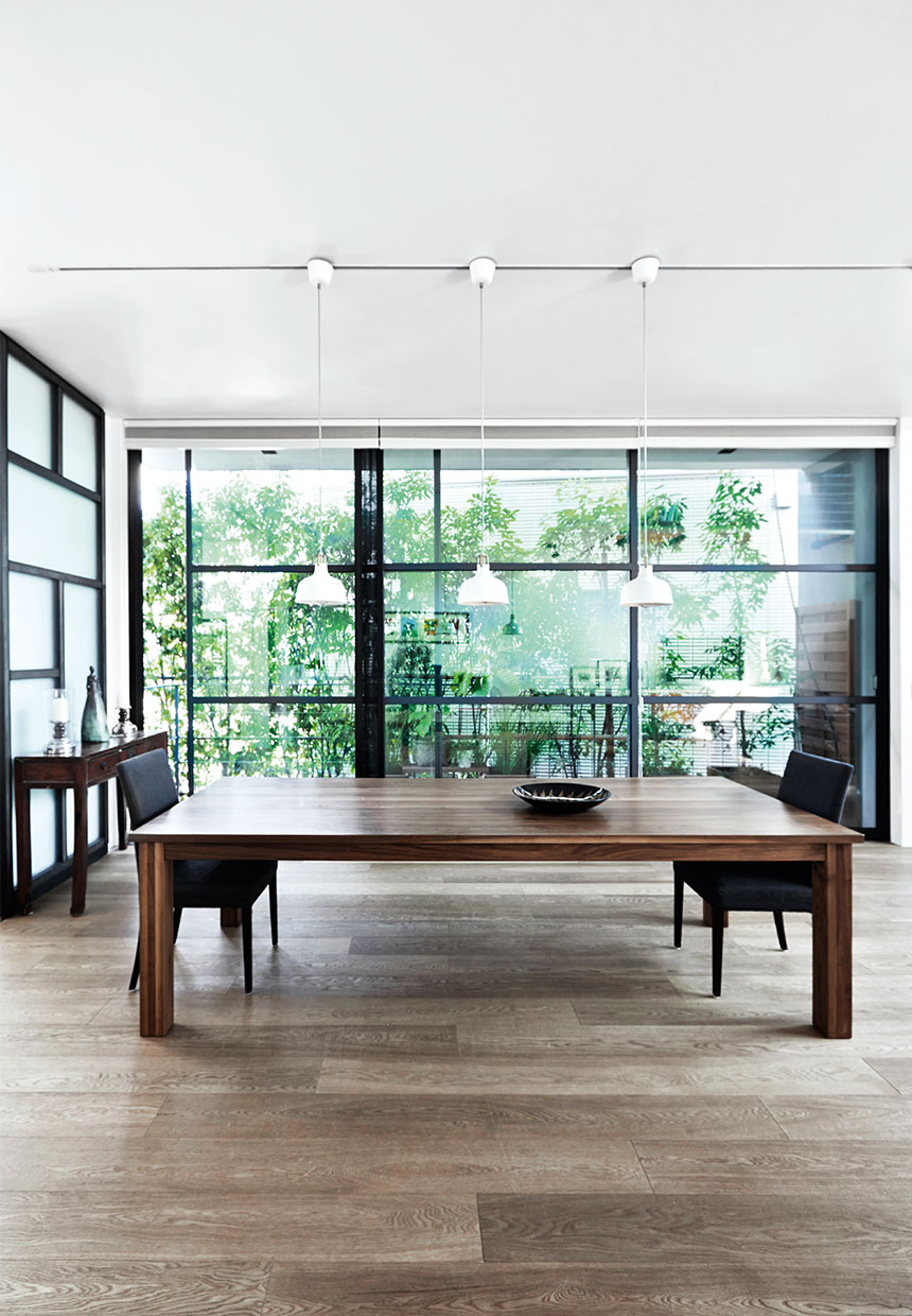 dining room with a large table and glass wall