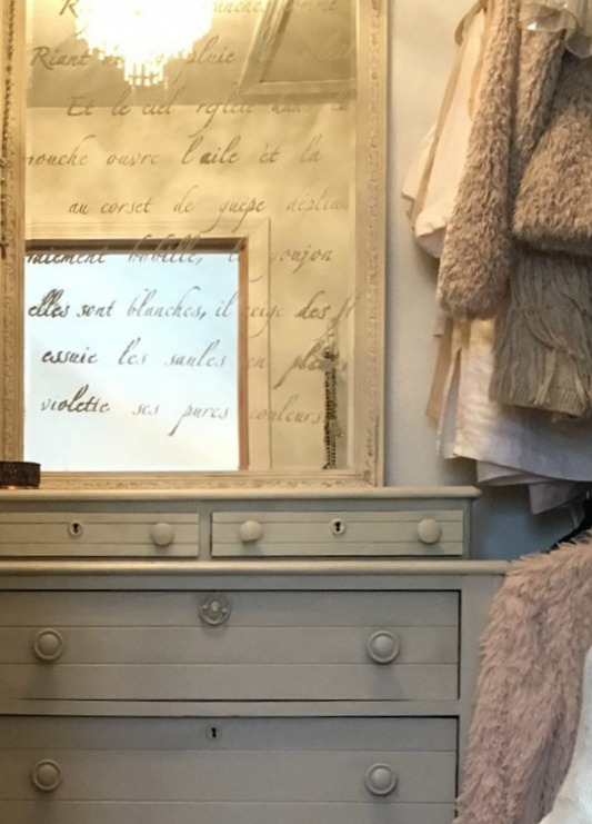 vintage dresser with stenciled mirror in a dressing room in master bedroom of Hello Lovely Studio's fixer upper