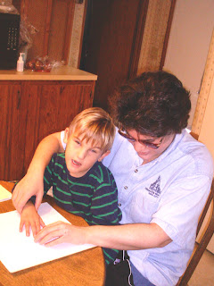 Laurel helps Dalton learn to track a Braille line