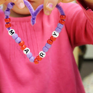 http://fun-a-day.com/fine-motor-valentine-craft-beaded-name-hearts/