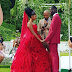 South African couple rock red on their wedding day