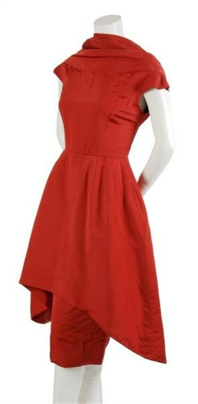 Red Silk 1950's dress with sculptured design by Pauline Trigere displayed on dress form