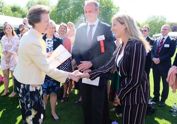 The Princess Royal and Princess Beatrice. Princess Anne wore a floral dress