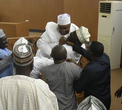 Dino Melaye Hugs Saraki Tightly After Supreme Court Victory