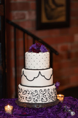 purple wedding decor and wedding cake