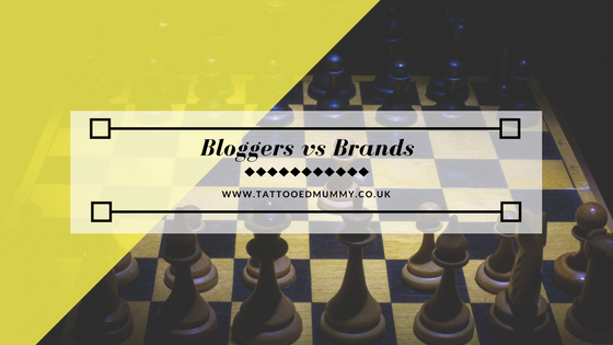 Bloggers Vs Brands superimposed over a chess board