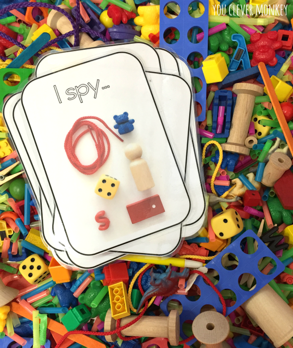 I Spy Sensory Tub Play - how to make your own I Spy Sensory tub for play. Use our FREE I Spy cards to help build maths rich vocabulary during play | you clever monkey