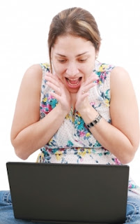 """Surprised Girl Looking In Laptop"" by David Castillo Dominici"