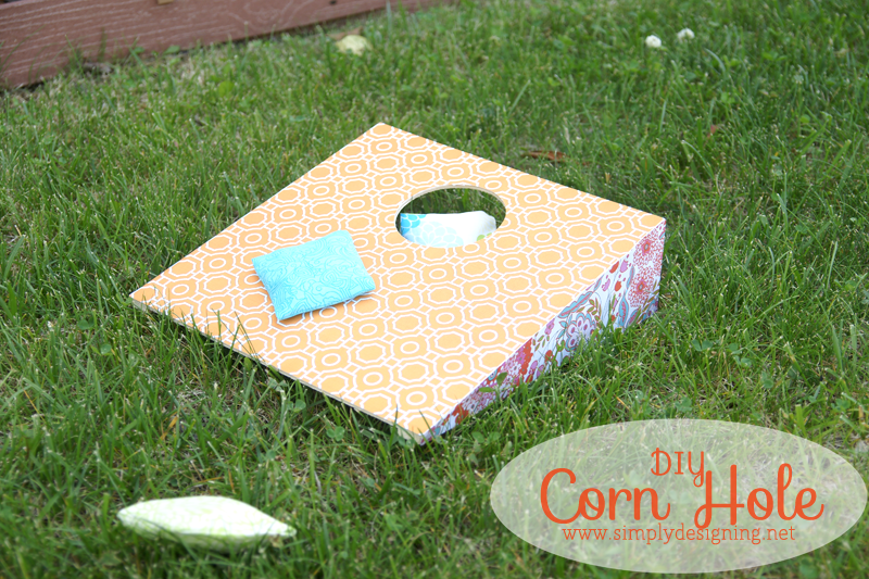 DIY Corn Hole | click to see how to create this really fun and simple corn hole game with bean bags! #cornhole #outdoorgames #kids #crafts