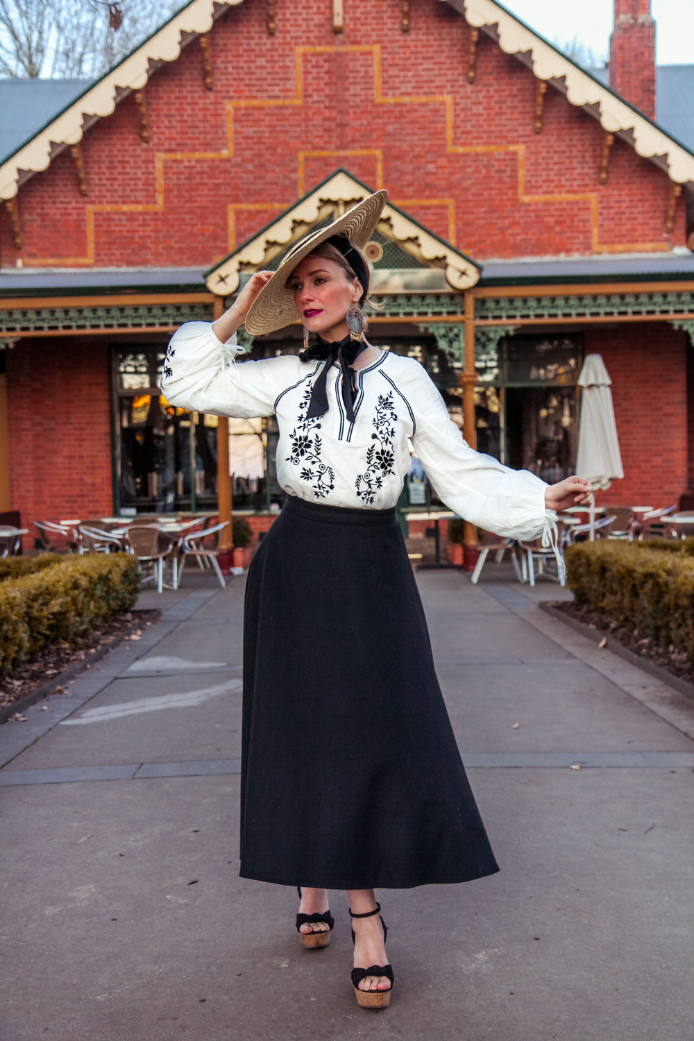 Liana of @findingfemme in Sportsgirl vyshyvanka embroidered top and black skirt