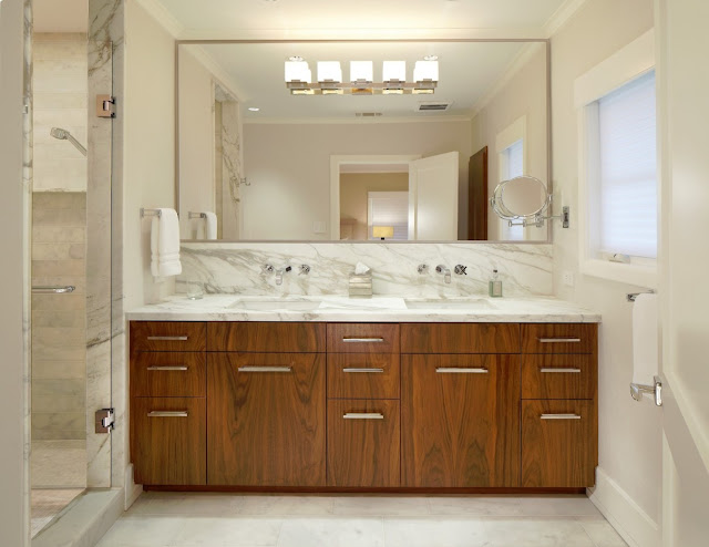 The Benefits of Adding Bathroom Mirrors to Counters and Cupboards
