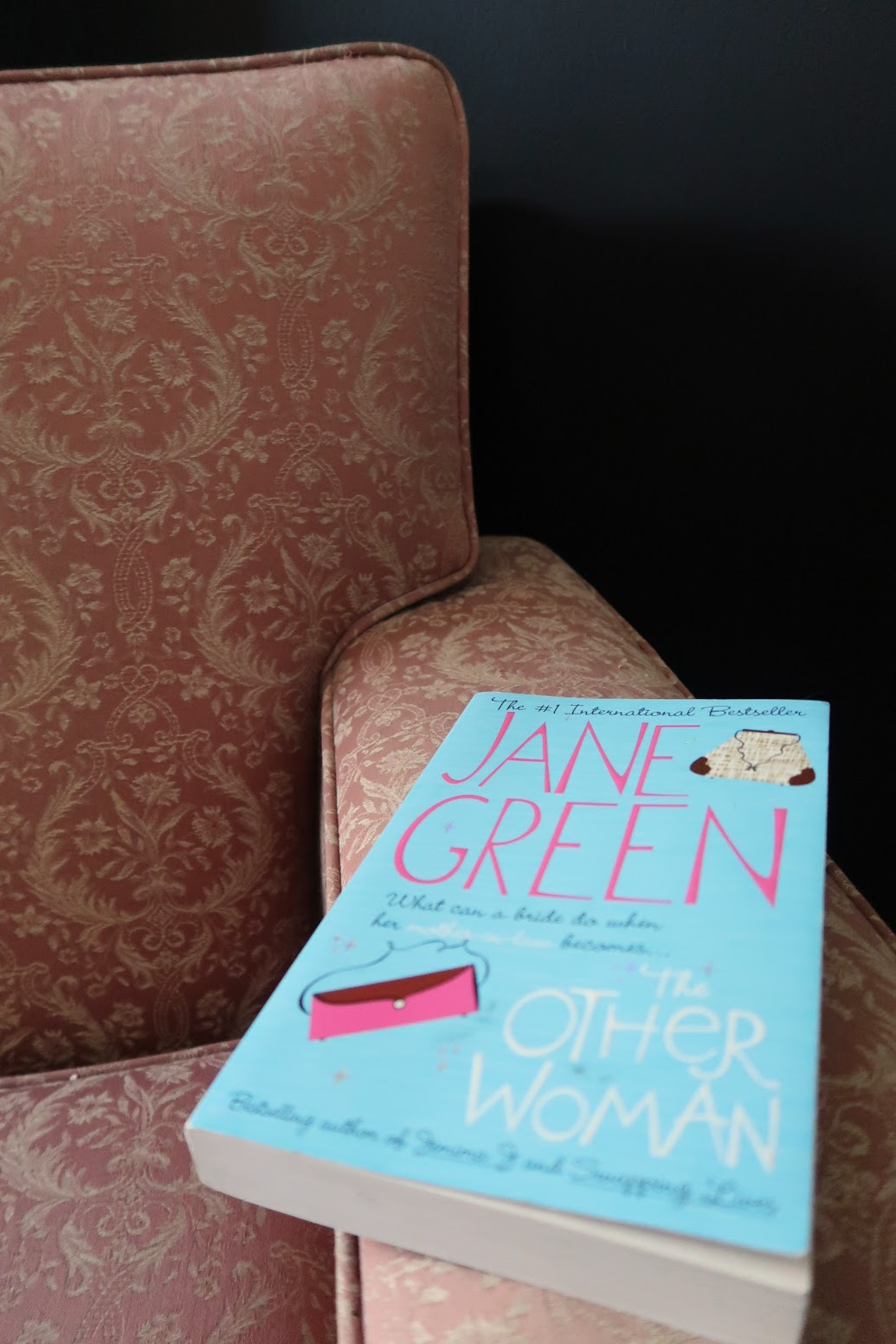 the other woman jane green book review summary rating novel black walls pink chair