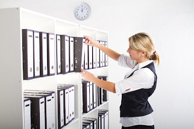 Archiving self storage solution by Boylin's Rotherham - Lady filling paperwork in office