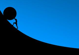 homem empurrando pedra gigante e subindo montanha