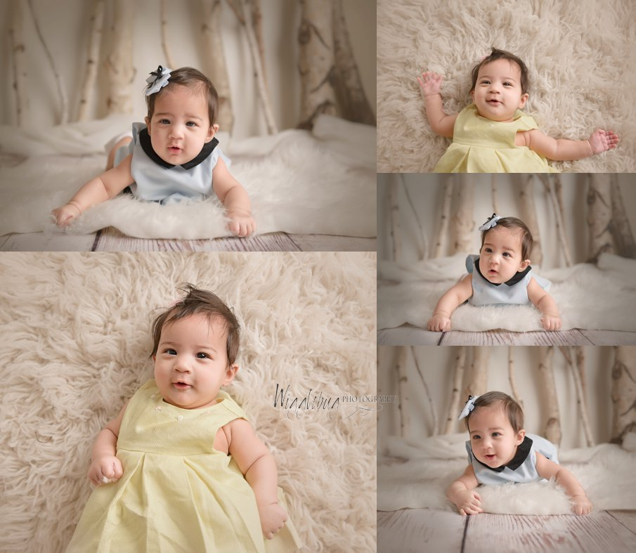4 month milestone photos in DeKalb, IL photography studio with baby girl in yellow dress