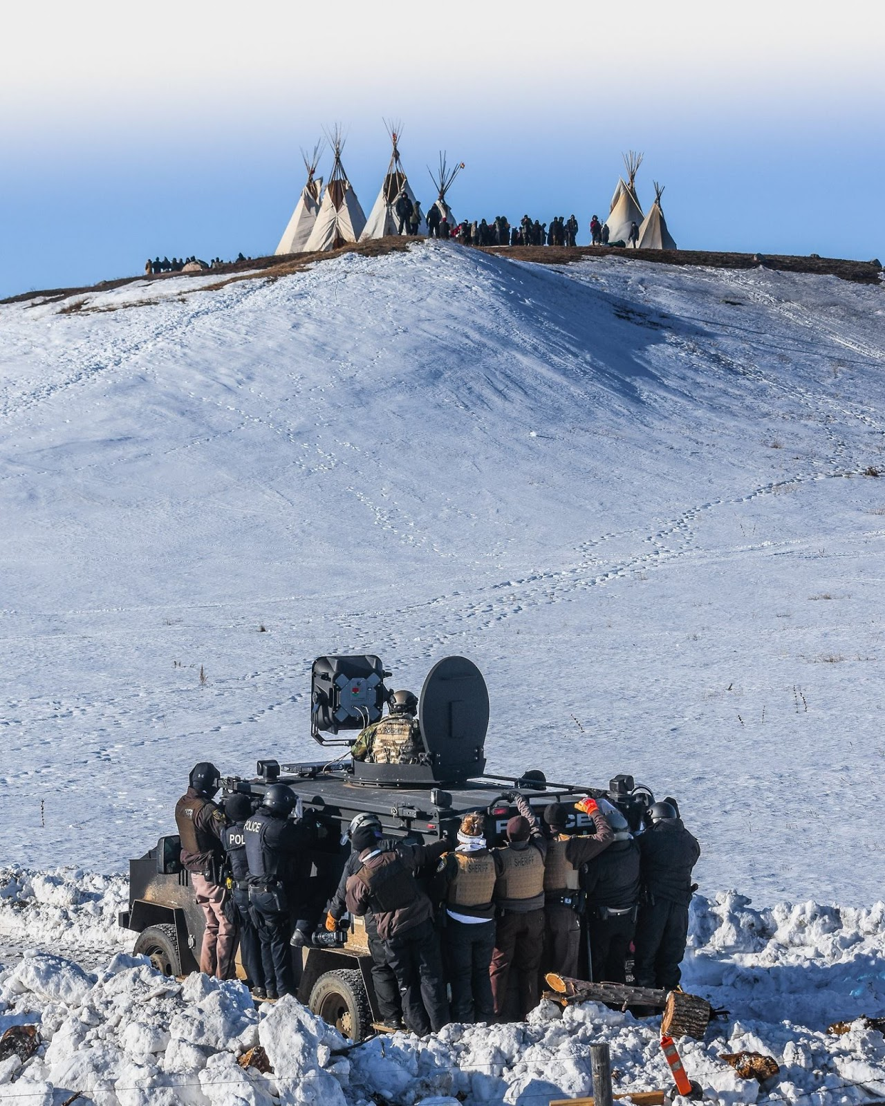 Image result for Police officers prepare to approach the Last Child Camp at Standing Rock in North Dakota on Feb. 1, 2017.