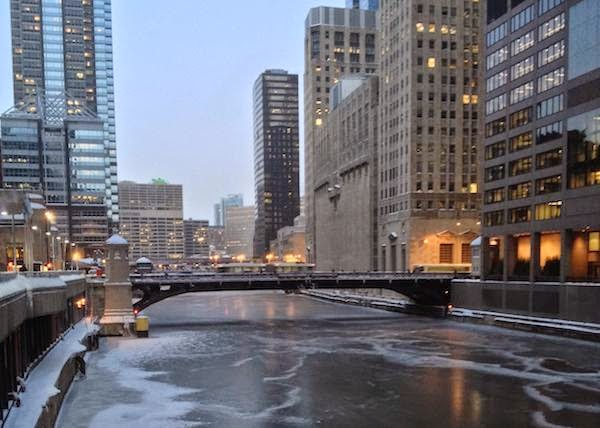 The Chicago river is completely frozen over. - The 30 Most Amazing Photos Of Frozen Things In Honor Of The Coldest Morning Of The 21st Century