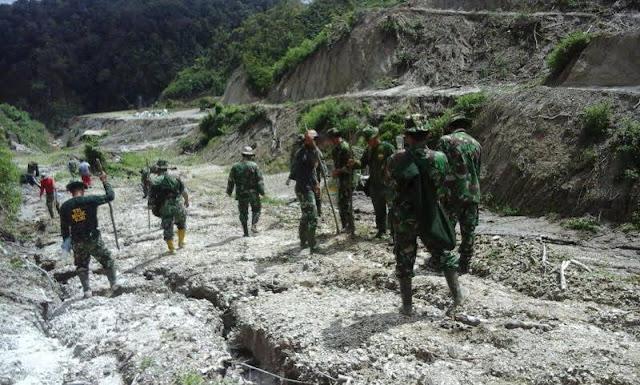 Bersama Masyarakat Nagori Dolok Mariah, Anggota Kodim 0207 / Simalungun Lanjutkan Penanaman Padi Gogo