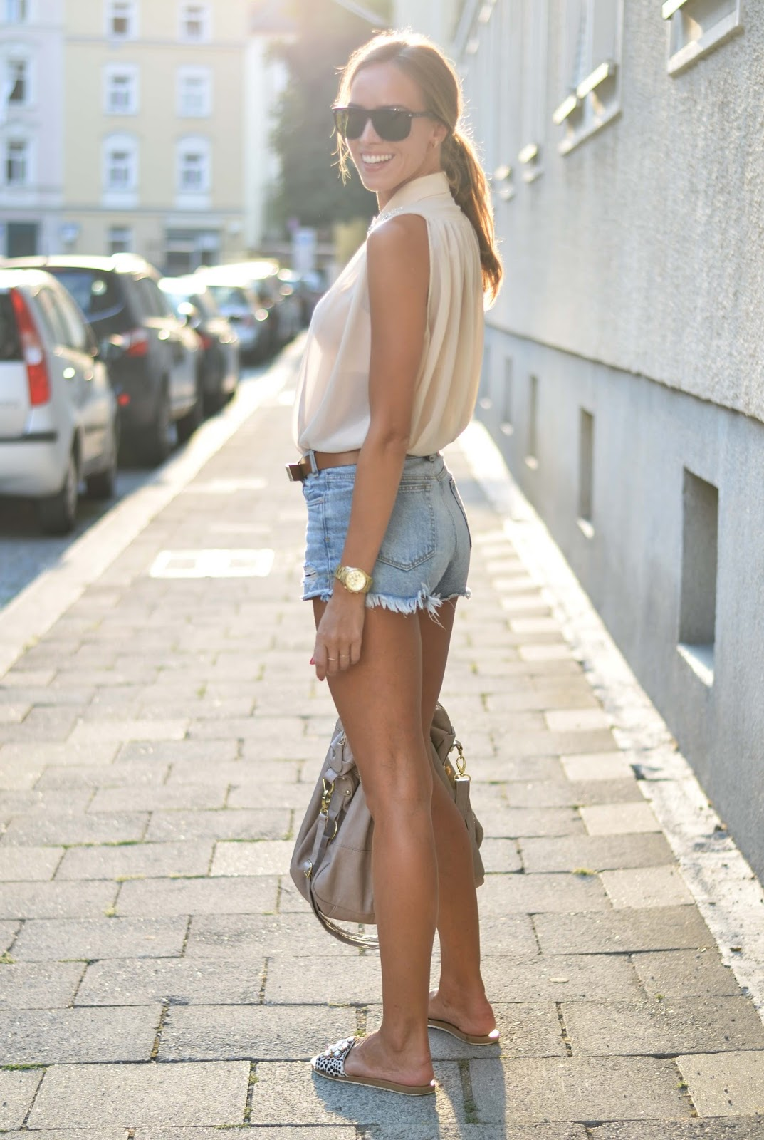 kristjaana mere denim shorts sleeveless top flat sandals summer outfit idea