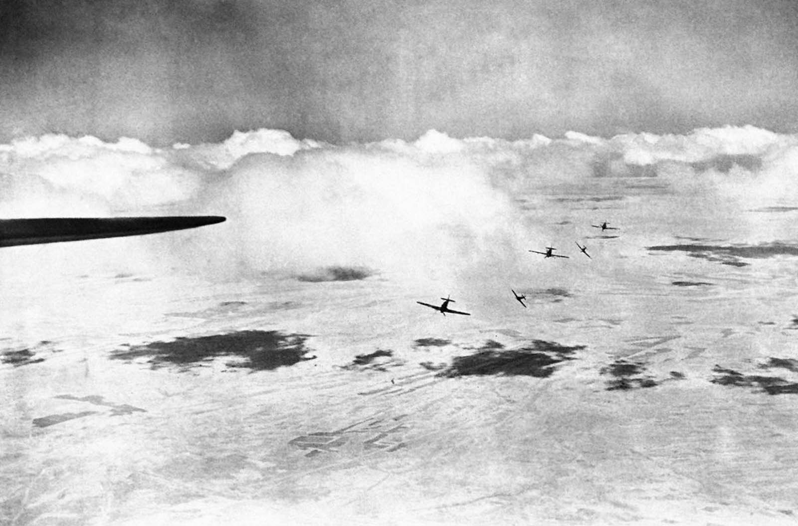 The moment a patrol of British Hurricane fighter planes, flying over a middle east sector, broke formation to attack enemy aircraft, on December 28, 1940.