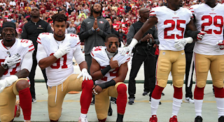 NFL players continue national anthem protests