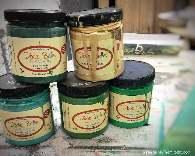five jars of Dixie Belle paint in shades of green, turquoise and a touch of gold