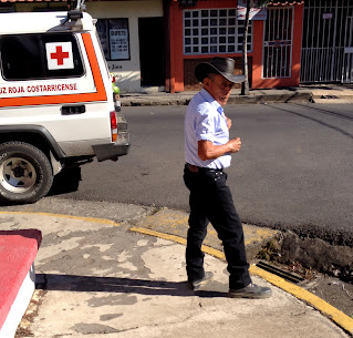 man in cowboy hat on Puriscal street corner