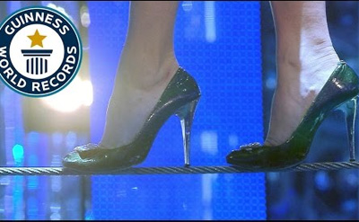Farthest tightrope walk in high heels // Guinness World Records Italian Show