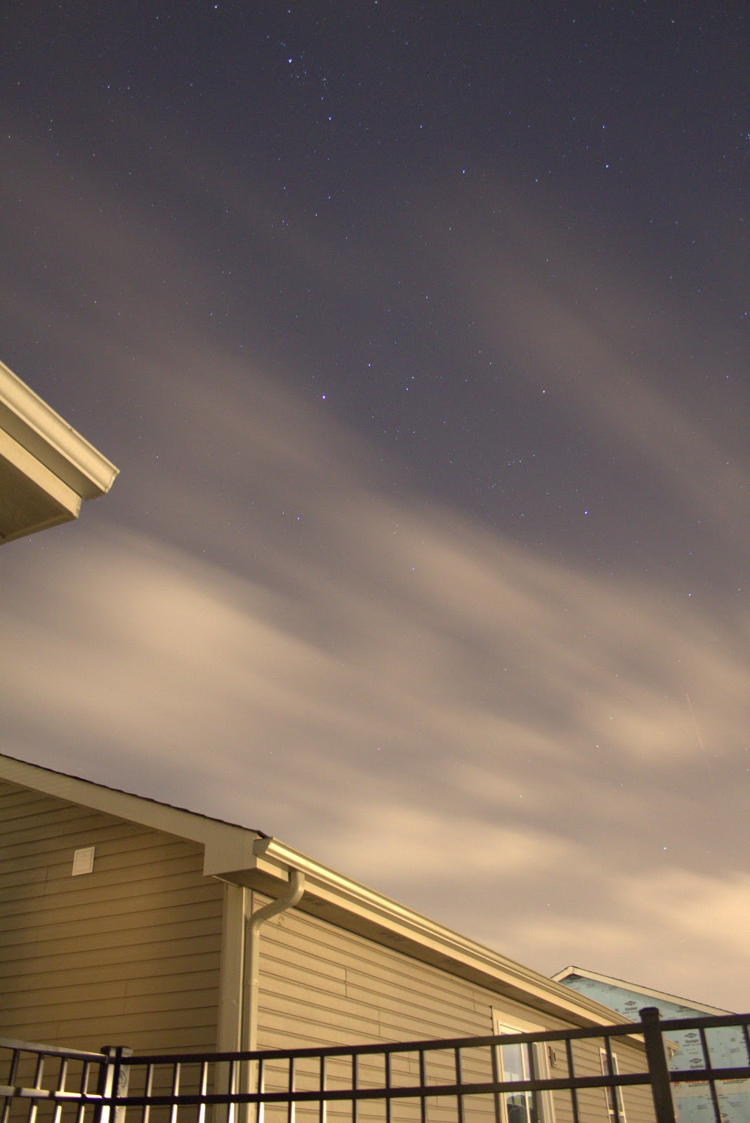 perseus constellation over house with clouds