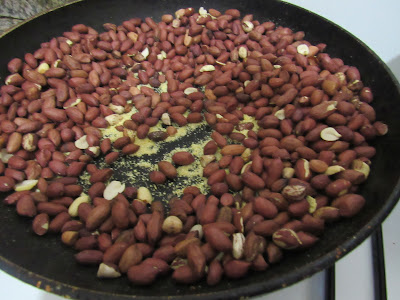 Roasting groundnuts with Nigerian garri