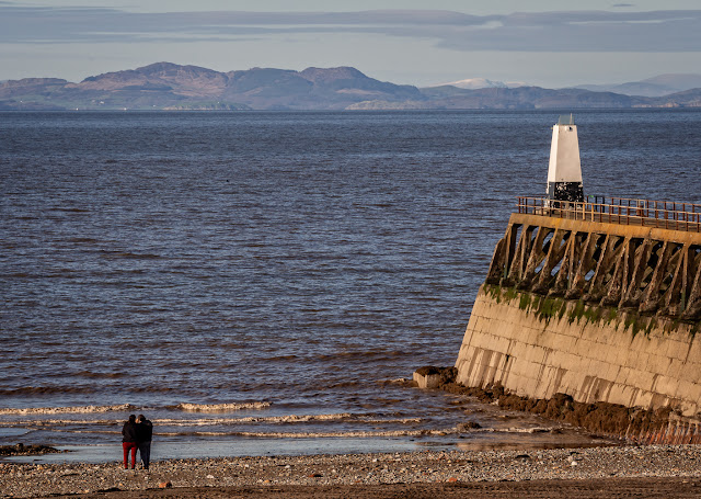 Photo of Maryport's south pier and the Scottish hills