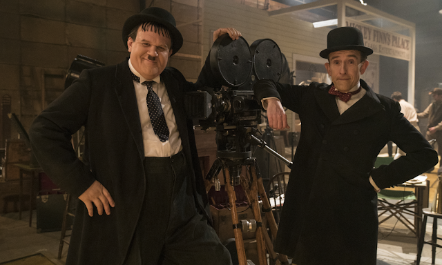 Stan Laurel and Oliver Hardy with a camera